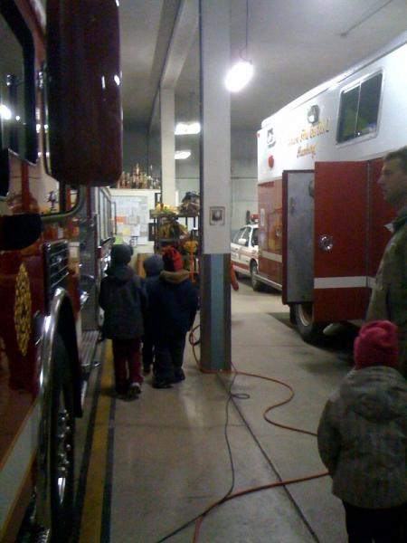 Tiger Scouts examining the fire apparatus.