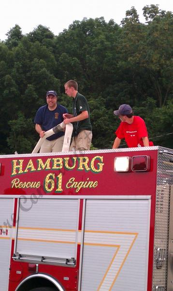 Loading the 2 1/2 Capt Thren, FF Tim Hartman and FF Shawn Hartman