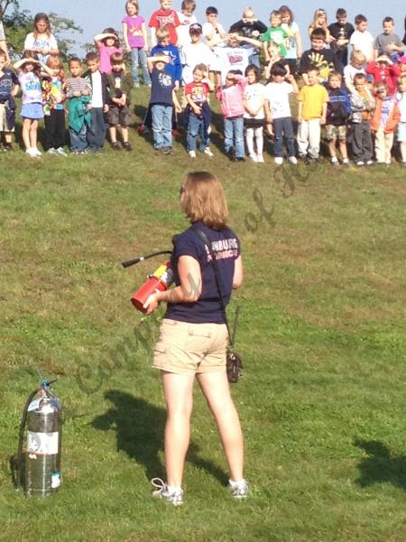 LT Thren going over how to use a fire extinguisher at tilden elm center