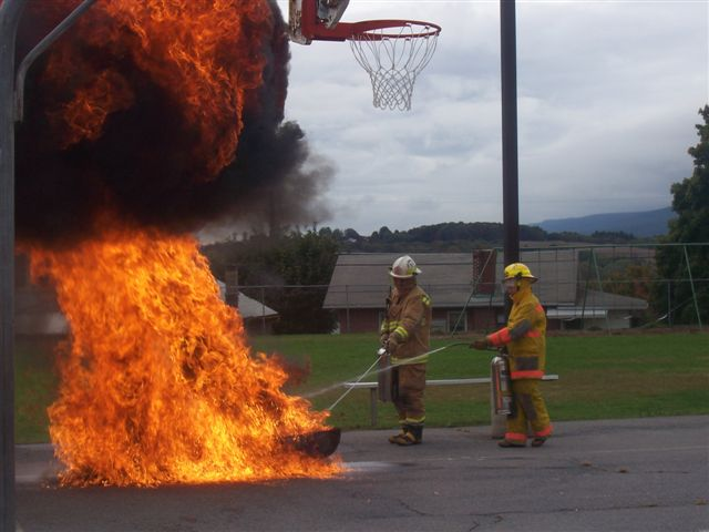 Firefighters demonstrate what happens when the wrong type of extinguisher is used.