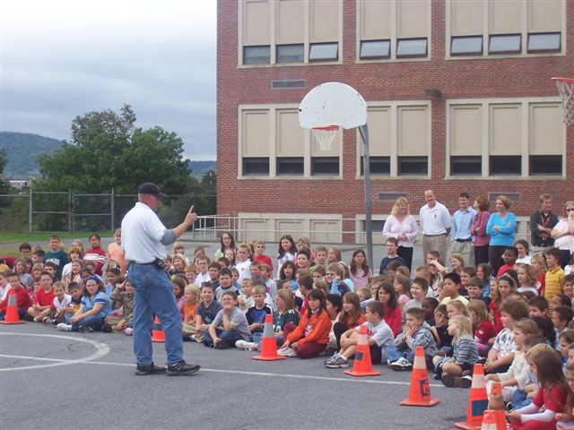 Chief Hatt talks to the children about fire safety and explains how to use a fire extinguisher.