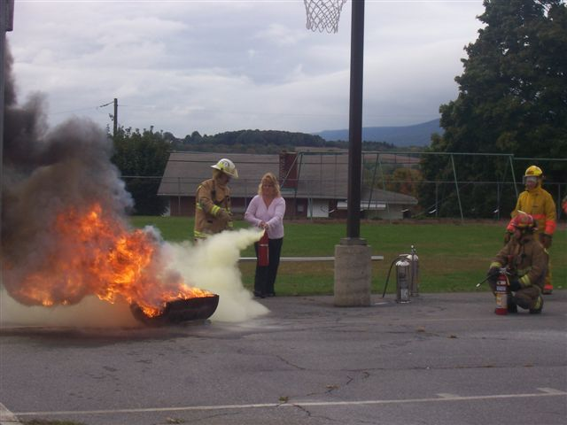 Even a few of the teachers got into the act, to show that anyone can use a fire extinguisher once they have a little training.