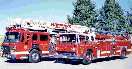 The 2000 American-LaFrance 100-foot aerial ladder and it's predecessor the 1961 65-foot aerial ladder truck.